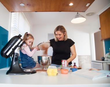 lady with child cooking in kitchen
